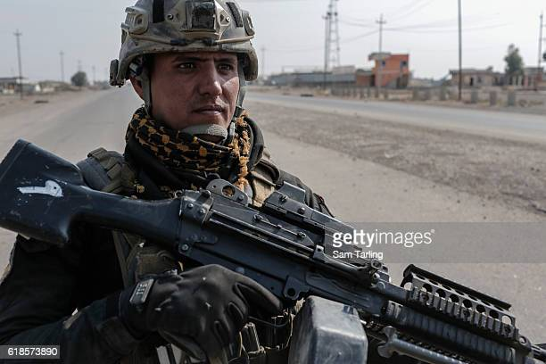 An Iraqi Golden Division soldier stands guard on October 27, 2016 in Bartella, Iraq. Bartella was recently captured from ISIS by Iraqi Special Forces...