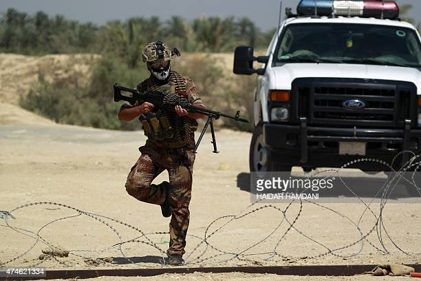 An Iraqi government forces member guards his surroundings in the Jurf alSakher area some 50 kilometres south of Baghdad to protect the area from...