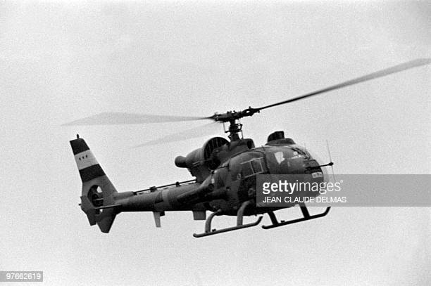 An Iraqi helicopter flies over the front line during the battle for the city of alHoweizah north of Basra on March 18 1985 The IraqIran war began in...