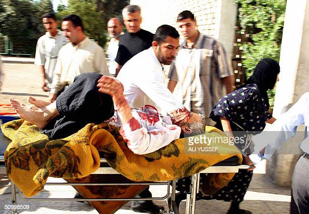 An Iraqi injured man is wheeled into a hospital 26 June 2004 in Baquba 60 kms northeast Baghdad The man was wounded by a group of armed men who...