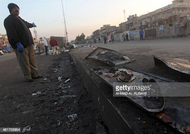 An Iraqi inspects on January 18 the aftermath scene of a motorcycle bomb attack near the Maridi market in the mostly Shiite Sadr City district of...