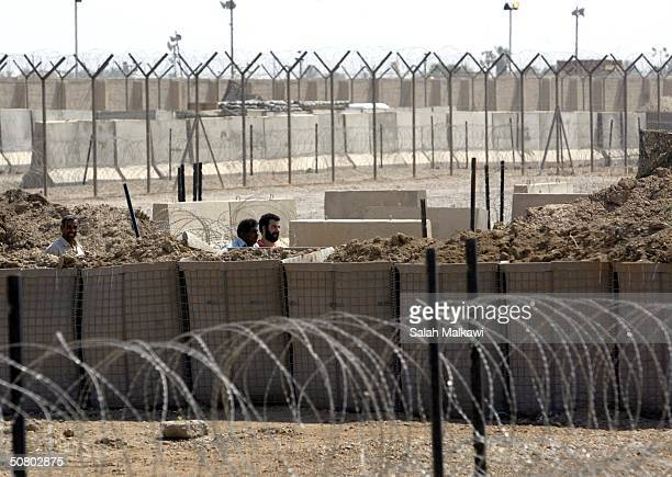 An Iraqi is released from Abu Ghraib prison May 5 2004 near Baghdad Some 2000 Iraqis demonstrated in front of the prison protesting the recent...