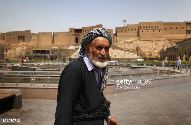 An Iraqi Kurdish man is seen in the square at the citadel and the City Park in Arbil the capital of the autonomous Kurdish region of northern Iraq on...