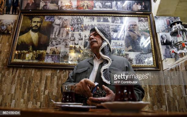 An Iraqi Kurdish man is seen next to cups of tea as he sits in a cafe in Arbil the capital of the autonomous Kurdish region of northern Iraq on...