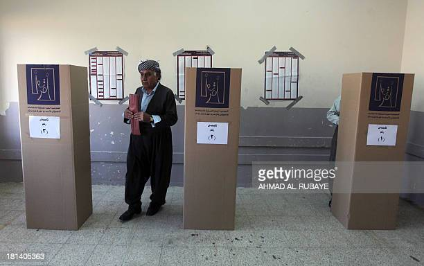 An Iraqi Kurdish man leaves a voting booth before casting his ballot during the Kurdistan's legislative election at a polling station on September 21...