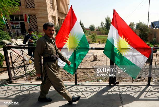 An Iraqi Kurdish man leaves after casting his ballot for the parliamentary election at a polling station in Arbil the capital of the Kurdish...