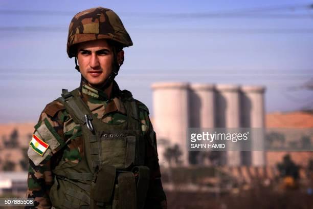 An Iraqi Kurdish Peshmerga stands guard near the Mosul Dam on the Tigris River around 50 kilometres north of the city of Mosul on February 1 2016 The...
