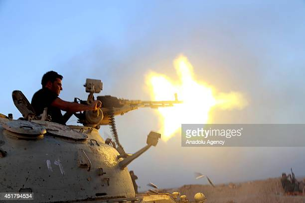 An Iraqi Kurdish Peshmerga takes aim in Diyala district as the clashes keep going between the army groups led by Islamic State of Iraq and the Levant...