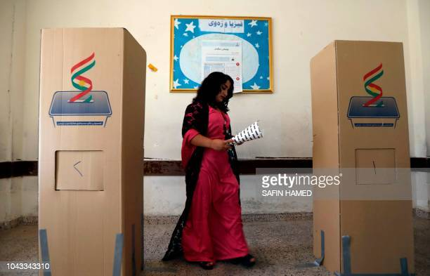 An Iraqi Kurdish woman casts her ballot for the parliamentary election at a polling station in Arbil the capital of the Kurdish autonomous region in...