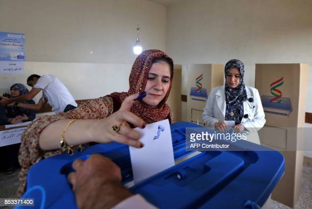 An Iraqi Kurdish woman casts her vote in the Kurdish independence referendum at a polling station in Arbil the capital of the autonomous Kurdish...