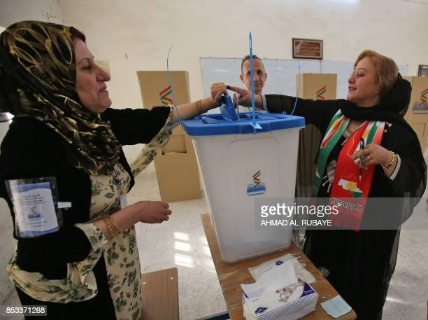 An Iraqi Kurdish woman cats her vote in the Kurdish independence referendum in the city of Kirkuk in northern Iraq on September 25 2017 Iraqi Kurds...