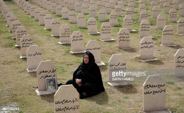 An Iraqi Kurdish woman visits the grave of her relative, Hafkar Omar Mustafa who was killed in a gas attack by former Iraqi president Saddam Hussein...