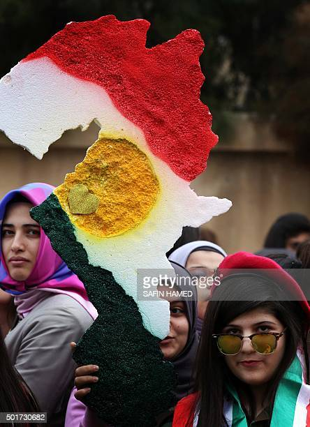 An Iraqi Kurdish youth holds a map of Kurdistan made from polystyrene during celebrations of marking Flag Day on December 17 2015 in Arbil the...