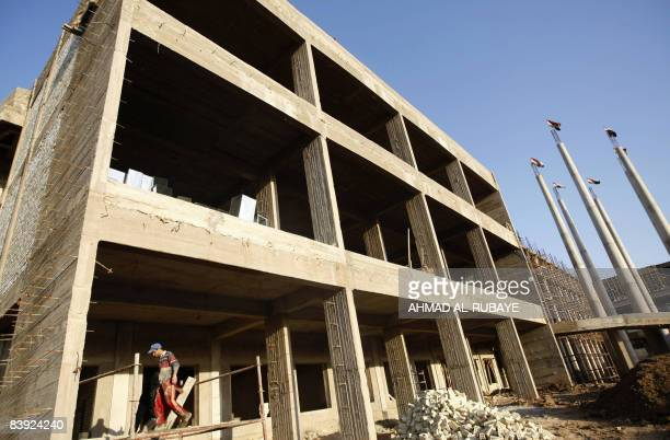 An Iraqi labourer works at a construction site in central Baghdad on December 5 2008 The real estate market is booming in the relatively more secure...