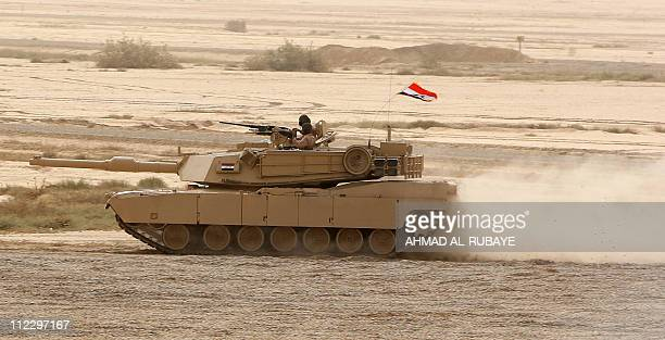 An Iraqi M1 Abrams tank roles along the sand at the start of the Lion's Leap Operation a joint USIraqi service exercise to demonstrate the Iraqi...