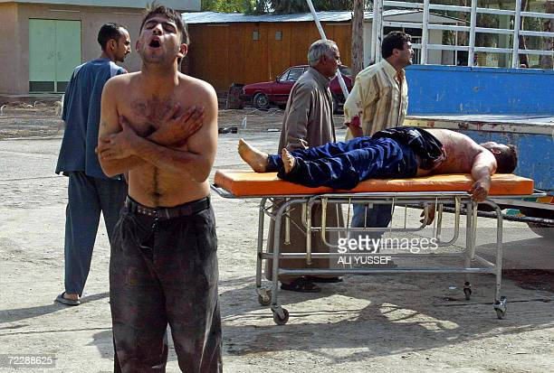 An Iraqi man beats himself in grief as he brings the bodies of his uncle and nephew to the local Baquba hospital morgue 60 kms northeast of Baghdad...