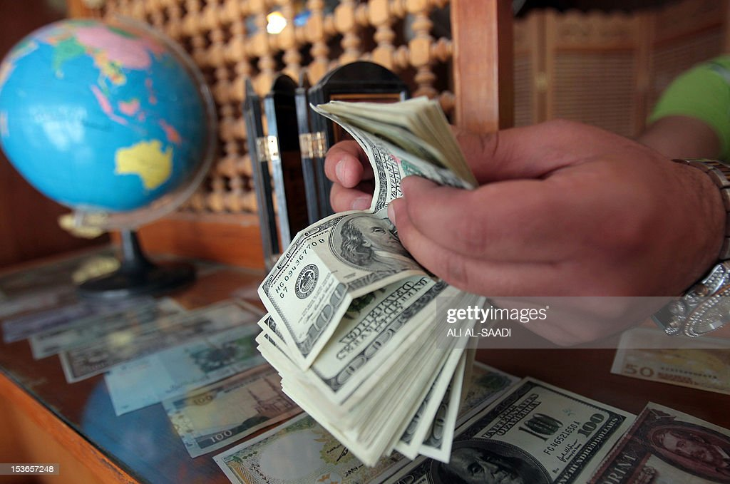 Currency exchange values are seen in the buy sell board of a