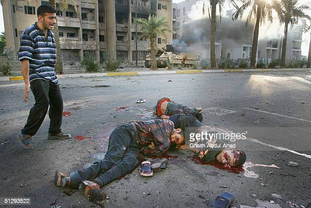 An Iraqi man despairs as he looks at dead civilians in the street on September 12 2004 in Haifa Street Baghdad Iraq Fighting broke out in the early...
