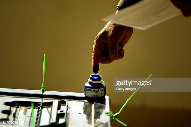 An Iraqi man dips his finger in ink after voting in the country provincial elections on January 28 2009 at the Medical City hospital in Baghdad Iraq...