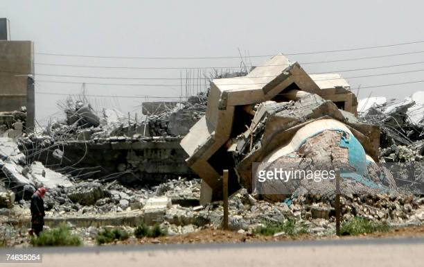 An Iraqi man inspects destruction inflicted to a Sunni mosque which was attacked in the city of AlZubair near the southern city of Basra 15 June 2007...