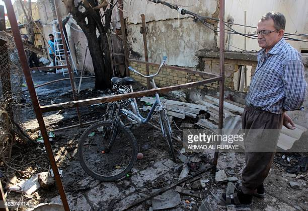 An Iraqi man inspects the site of a car bomb explosion in the Taubchi neighbourhood of the capital Baghdad on January 19 a day after the attack The...