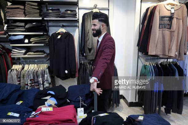 An Iraqi man is pictured at a clothing store on the eastern bank of the Iraqi city of Mosul on January 9 six months after chasing out the jihadists...