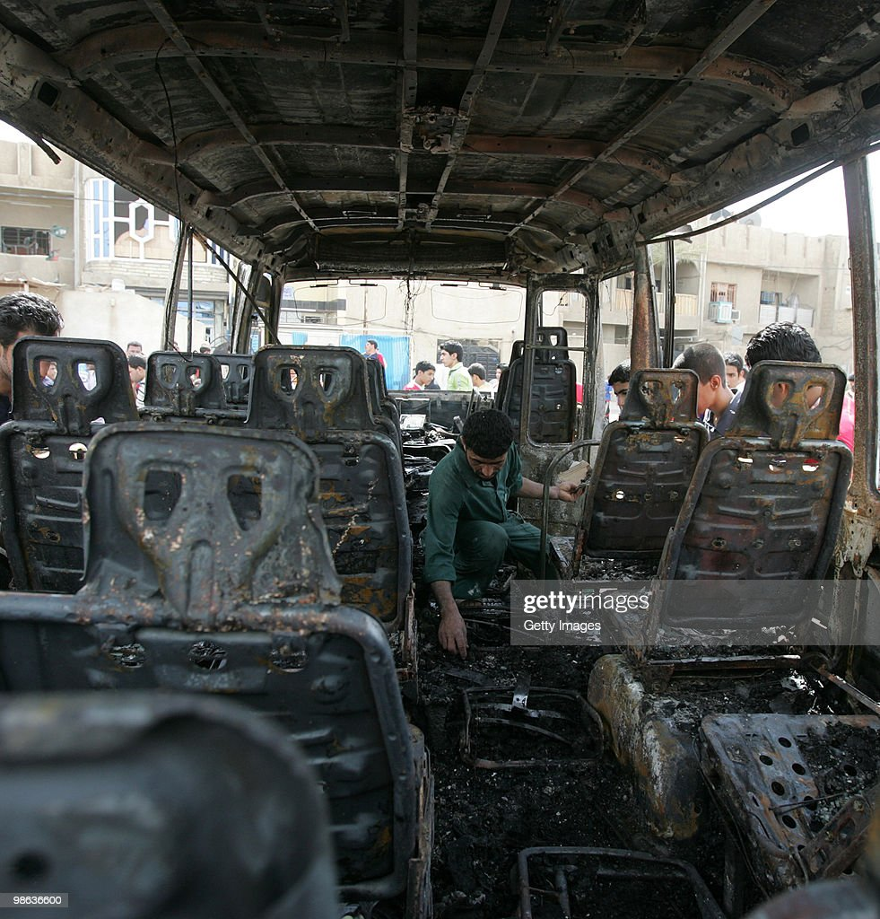 An Iraqi man is seen inside a car damaged in a car bomb explosion in Sadr city on April 23, 2010 in Baghdad, Iraq. A series of bombings rocked a market and Shiite mosques as worshippers departed Friday Prayer services, killing at least 60 people and wounding many more.