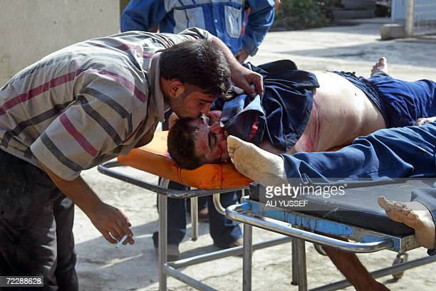 An Iraqi man kisses his dead uncle after bringing his body to the local Baquba hospital morgue 60 kms northeast of Baghdad after they were shot and...