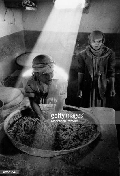 An Iraqi man kneading bread in a bakery Baghdad December 1956