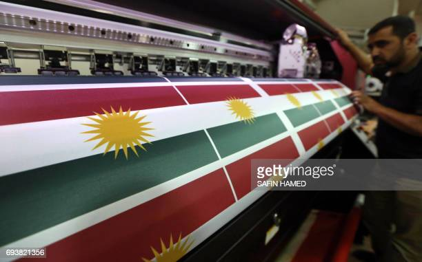 An Iraqi man prints a flag of Kurdistan in Arbil the capital of the autonomous Kurdish region of northern Iraq on June 8 2017 Iraq's autonomous...