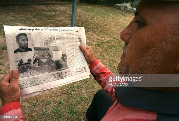 An Iraqi man reads an article allegedly picturing Abu Omar alBaghdadi said to be the leader of the AlQaeda umbrella group in Iraq on April 29 in...