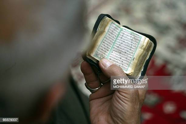 An Iraqi man reads from a small copy of the Koran during Friday prayers in the holy Shiite city of Karbala on April 11 2008 Gunmen shot dead a top...