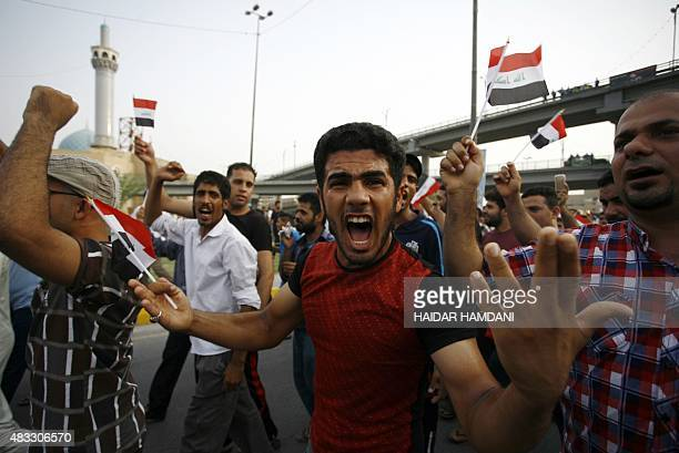 An Iraqi man shouts slogans and waves his national flag during a demonstration against corruption and poor services on August 7 2015 in the holy city...