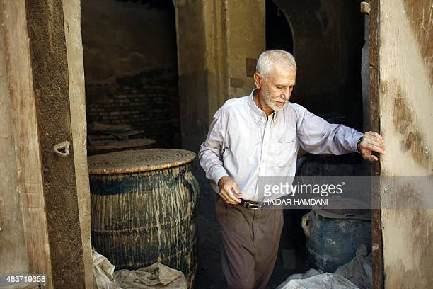 An Iraqi man stands in an ancient building used at the time to cool drinking water in what was a Jewish neighbourhood in the Iraqi city of Hilla...