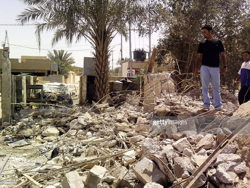 An Iraqi man stands in the rubble after four house bombs exploded early morning in Khaldiya, 75 kilometers (47 miles) from the capital Baghdad on April 23, 2010. A series of five car bombs, three during prayers at Shiite mosques in Baghdad, and other attacks across Iraq killed 58 people on Friday, just days after the government said Al-Qaeda was on the run.