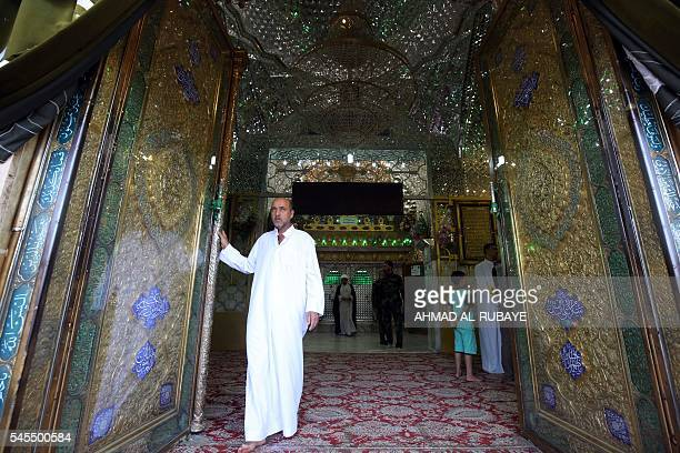 An Iraqi man stands inside the Sayyid Mohammed shrine in the Balad area located 70 kilometres north of Baghdad on July 8 in the aftermath of a mortar...