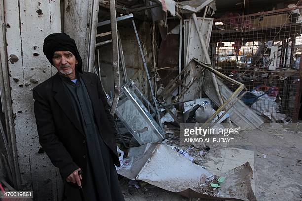 An Iraqi man stands near debris in the aftermath of an explosion in the Ur district in eastern Baghdad on February 18 2014 Attacks in Iraq including...
