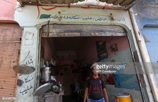 An Iraqi man stands next to his cafe in the old city in western Mosul on July 30 2017 / AFP PHOTO / SAFIN HAMED