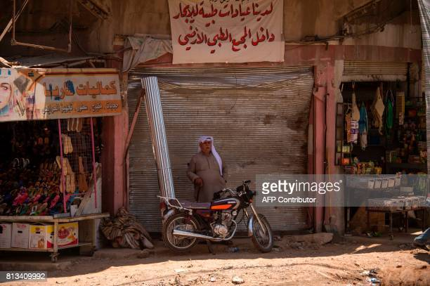TOPSHOT An Iraqi man stands outside a shop in west Mosul on July 12 2017 a few days after the government's announcement of the 'liberation' of the...