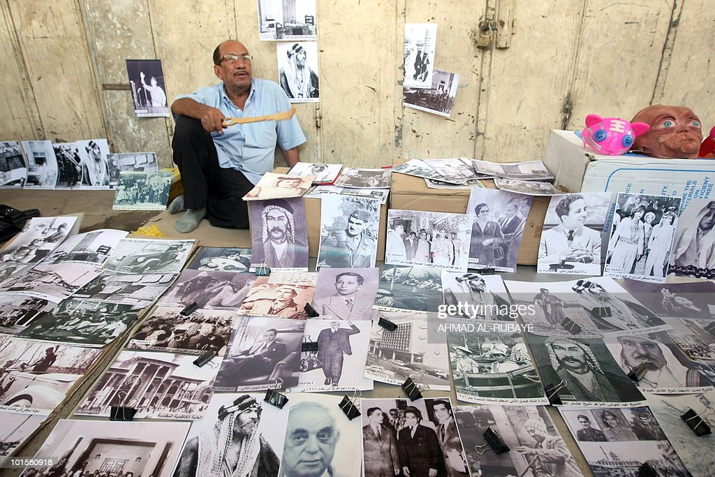 An Iraqi man waits for customers as he sells reproduction black and white images of Iraqi politicians and the former royal family at the al-Ghazel market which is mainly famous for selling pet animals and livestock in Baghdad, on May 21, 2010. The site is popular on with Iraqis on Friday, the weekend in Iraq.