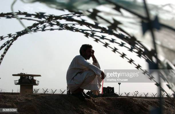 An Iraqi man waits for the release of his relative detained in the Abu Ghraib prison May 21 2004 outside of Baghdad Iraq More than 400 prisoners were...