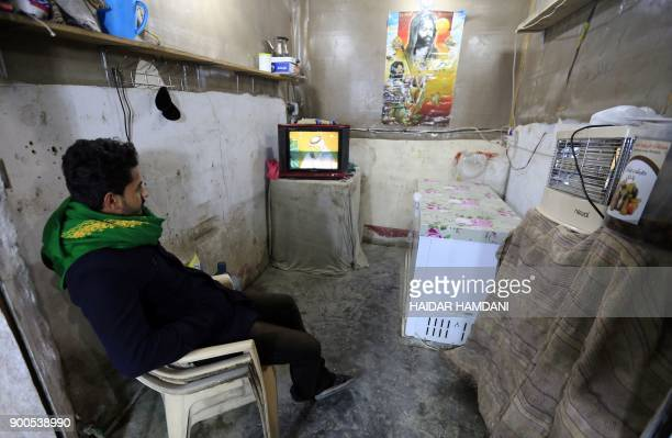 TOPSHOT An Iraqi man waits to watch the 2017 Gulf Cup of Nations semifinal football match between Iraq and UAE at his home in the Shiite holy city of...