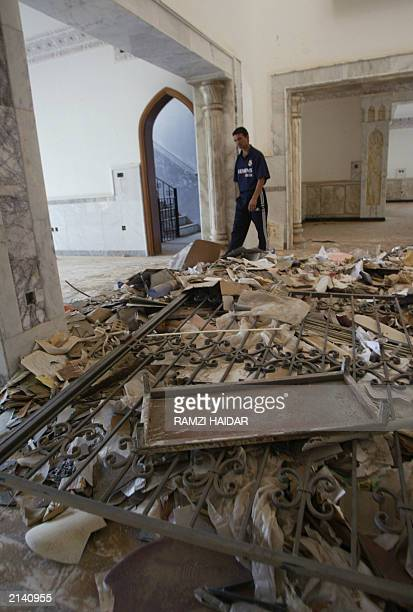 An Iraqi man walks 19 June 2003 in one of the rooms in the home of toppled leader Saddam Hussein's most trusted lieutenant Abid Hamid Mahmud knwon as...