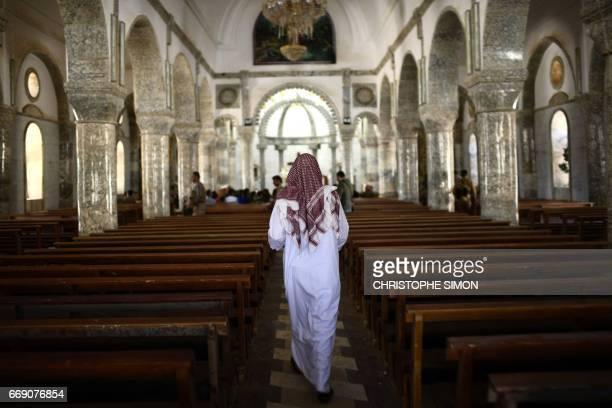 An Iraqi man walks inside the Saint John's church in the nearly deserted predominantly Christian Iraqi town of Qaraqosh some 30 kilometres from Mosul...