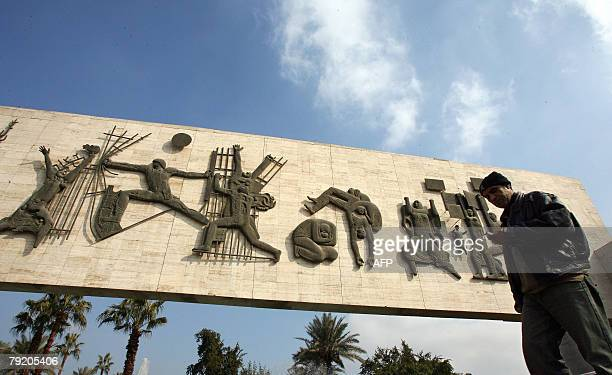 An Iraqi man walks past the Monument of Liberty in central Baghdad 24 January 2008 Cracks in the base of the monument raised fears of collapse among...