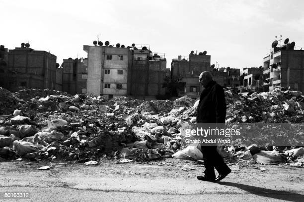 An Iraqi man walks through the streets February 2in the district of Jaramana on the edge of Syrian capital Damascus Sectarian violence and civil war...