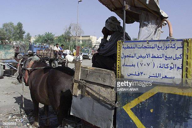An Iraqi man who owns a horsedrawn cart to sell propane gas waits for the truck that is due to deliver propane from the refinery in Baghdad 23...