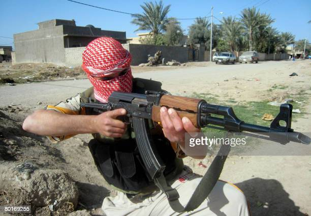 An Iraqi member of Concerned Local Citizens committees that fight Al-Qaeda, takes a combat position as he patrols an area north of the restive city...