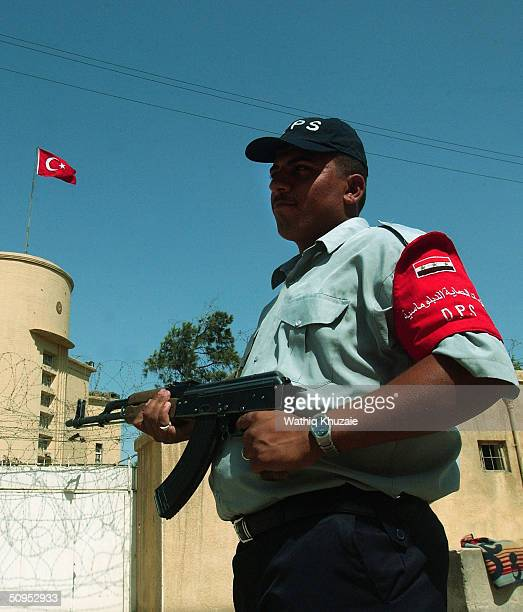 An Iraqi member of the diplomats protection force stands guard in front of the Turkish embassy June 12 2004 in Baghdad Iraq Seven Turkish contractors...