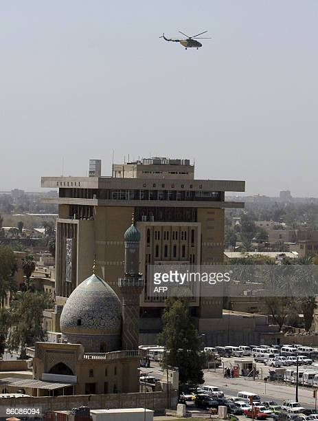 An Iraqi military helicopter patrols the skies over the 'Green Zone' which houses the Iraqi parliament and the American embassy in central Baghdad on...